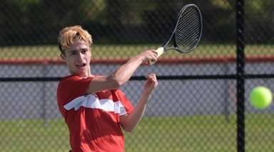 Southold GreenportÕs Xavier Khan returns the serve during