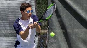 Logan Fiegel, Hewlett, plays doubles against Mikey Weitz
