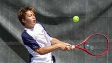 Stephan Gershfeld of Hewlett plays doubles against Mikey