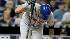 New York Mets' Juan Lagares reacts after he
