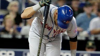 New York Mets' Juan Lagares reacts after he