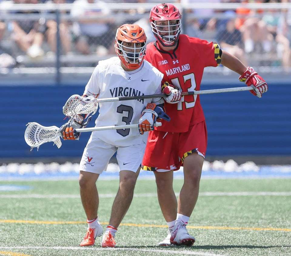 Virginia's Ian Laviano (3) sets up in front