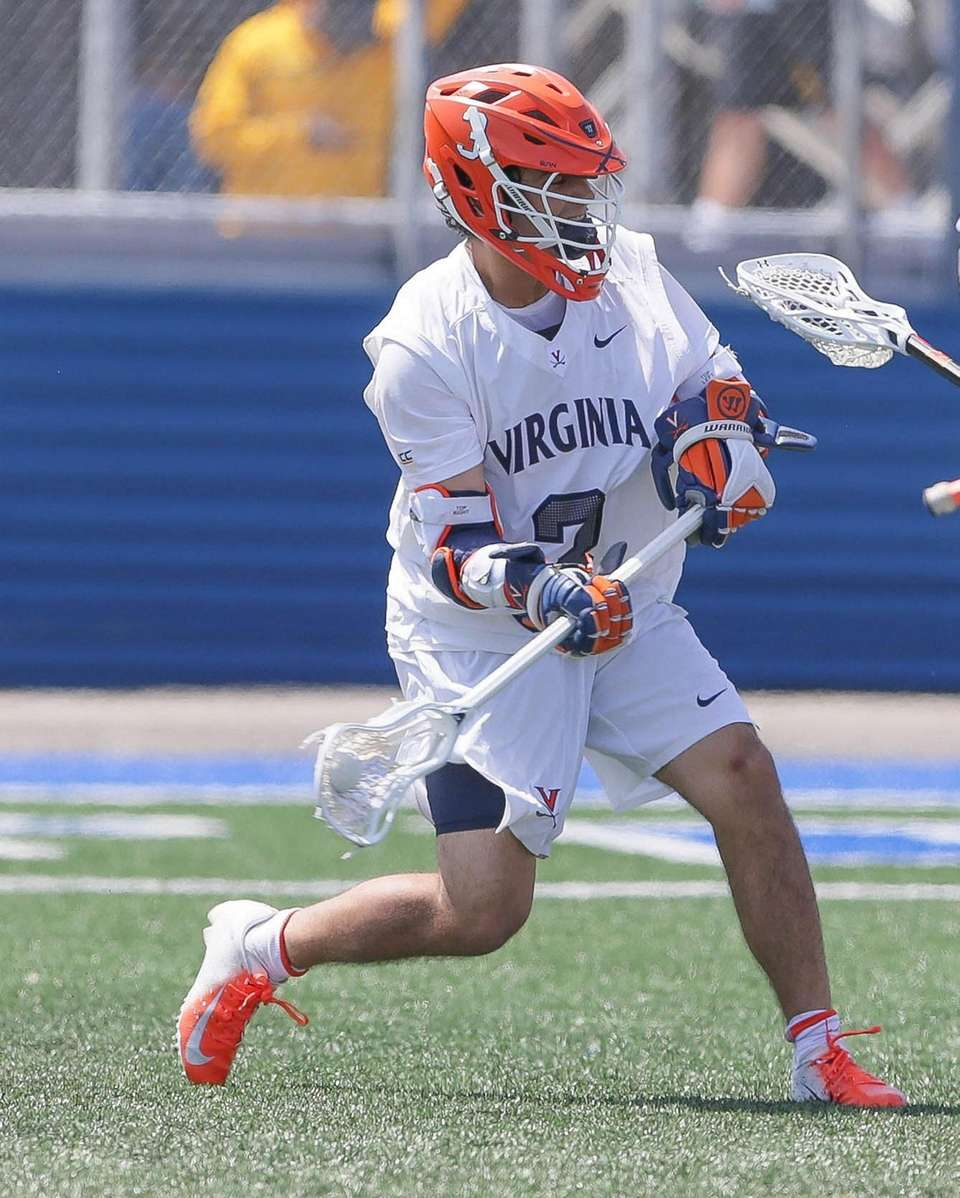Virginia's Ian Laviano (3) shoots and scores in
