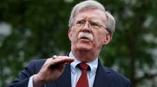 National Security Adviser John Bolton talks to reporters