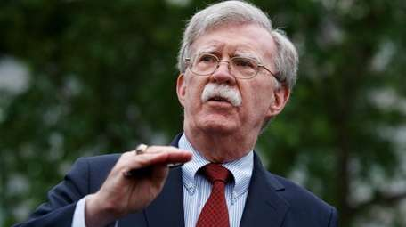 National Security Adviser John Bolton talks to reporters