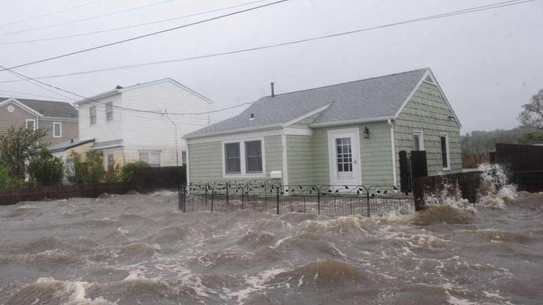 The tide floods a house in Patchogue during