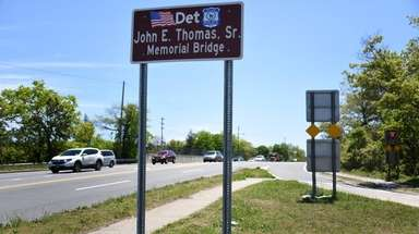 A sign honoring Detective John Thomas, the first