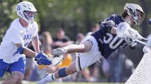 Notre Dame's Ryder Garnsey (50) goes airborne while