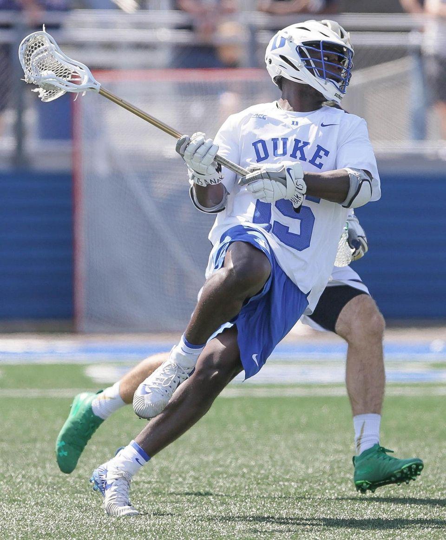 Duke's Nakeie Montgomery (15) takes a shot in