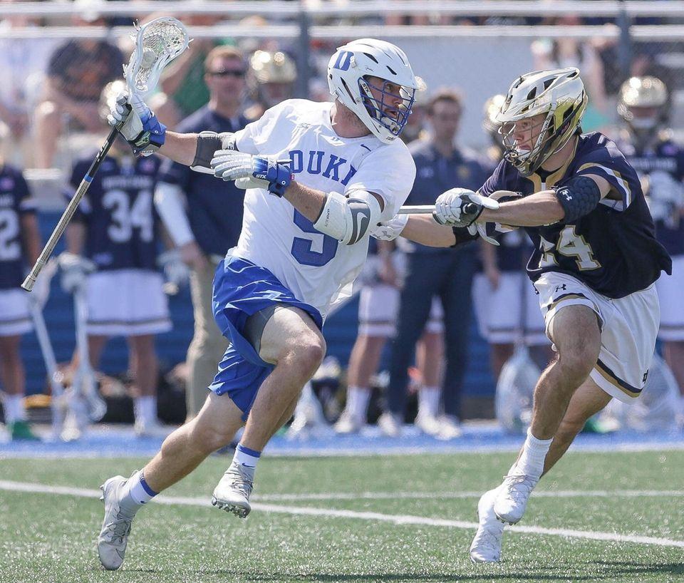 Duke's Sean Lowrie (9) looks to get around