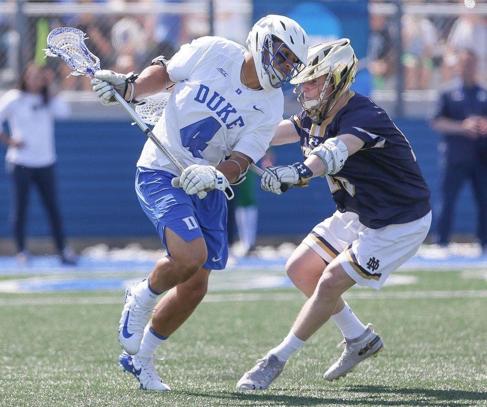 Duke's Jake Seau (4) looks to get around