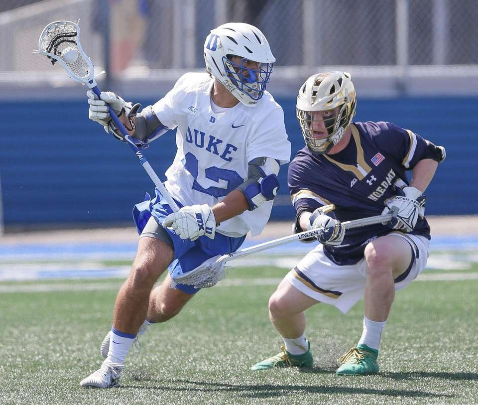 Duke's Reilly Walsh (42) tries to get around