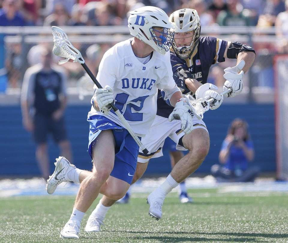 Duke's Kevin Quigley (12) looks to get around