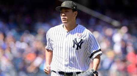 Masahiro Tanaka of the Yankees reacts against the