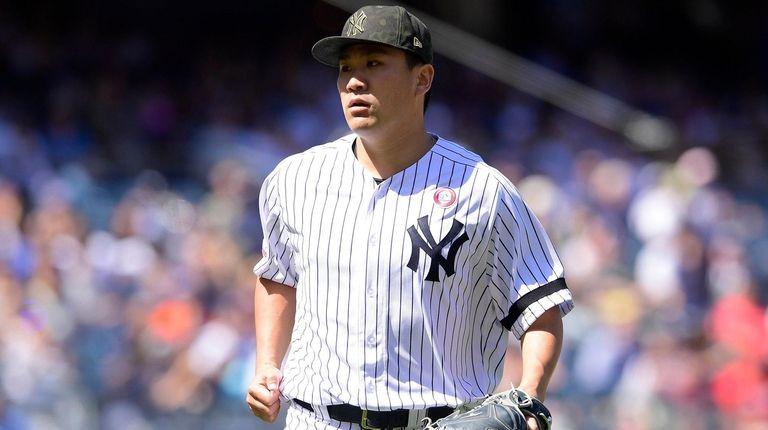 Masahiro Tanaka of the Yankees reacts against the