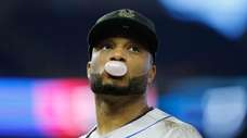 Robinson Cano of the Mets looks on against
