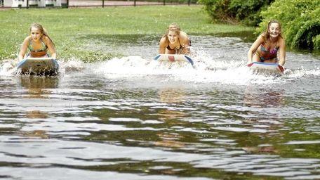 Meghan Greene, 9, left, Kristen Greene, 15, center,