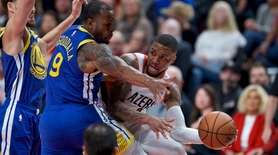 Portland Trail Blazers guard Damian Lillard, right, passes