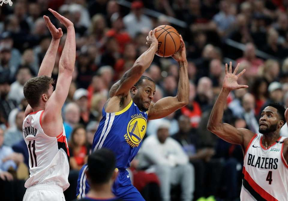Golden State Warriors guard Andre Iguodala, center, is