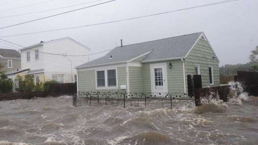 The tide floods a property in Patchogue during