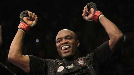 Defending middleweight champion Anderson Silva of Brazil celebrates