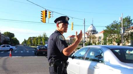 Garden City police officer George Byrd directs traffic