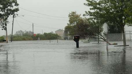 Flooded streets in the Mastic Beach area. (Aug.