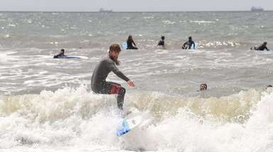 Will Skudin, co-founder of Skudin Surf, instructs young