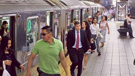 Commuters step off the subway August in New