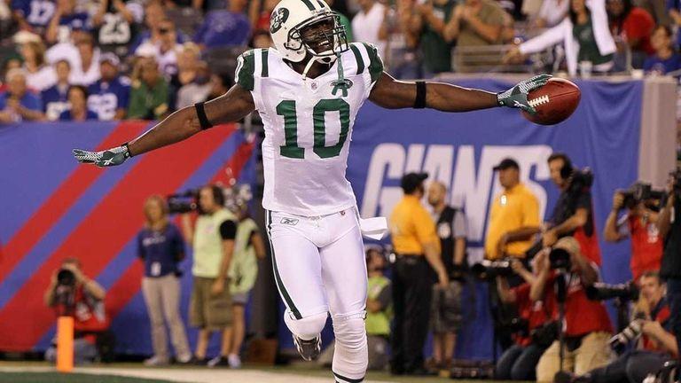 Santonio Holmes of the New York Jets celebrates