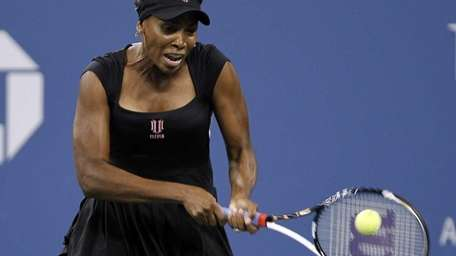 Venus Williams with the backhand return of a