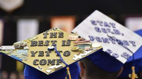 Hofstra graduates with decorated mortarboards on Sunday.