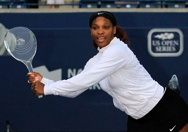 Serena Williams poses for photographers with the Rogers