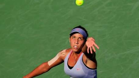 Madison Keys of the United States serves the