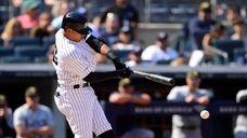 Thairo Estrada #30 of the Yankees hits a