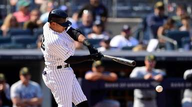 Thairo Estrada #30 of the Yankees hits a