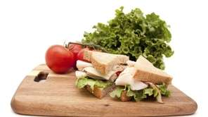A turkey breast sandwich, lettuce and vine ripe