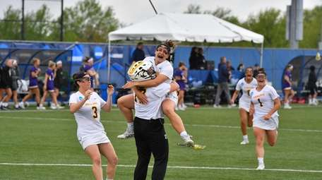 Adelphi's Nicki Stanco jumps into the arms of