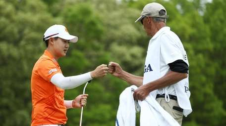 Jazz Janewattananond of Thailand reacts to his putt
