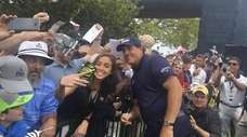 Phil Mickelson with fans on the autograph line