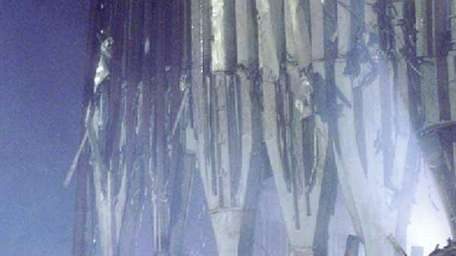 Rescue workers continue to search the debris of