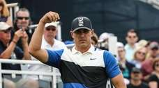 Brooks Koepka prepares to tee off on the