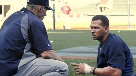With his left thumb wrapped, Alex Rodriguez talks