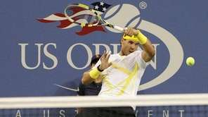 Rafael Nadal of Spain returns the ball to