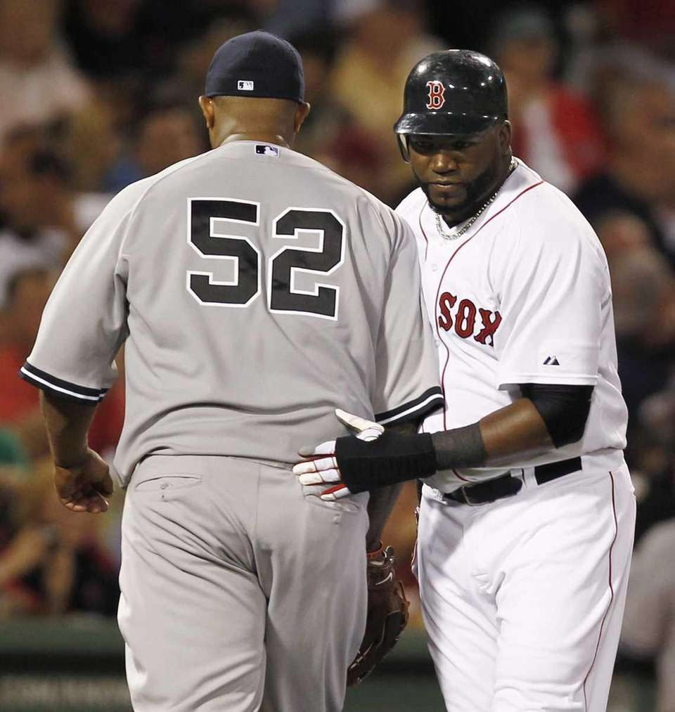 Boston Red Sox designated hitter David Ortiz pats