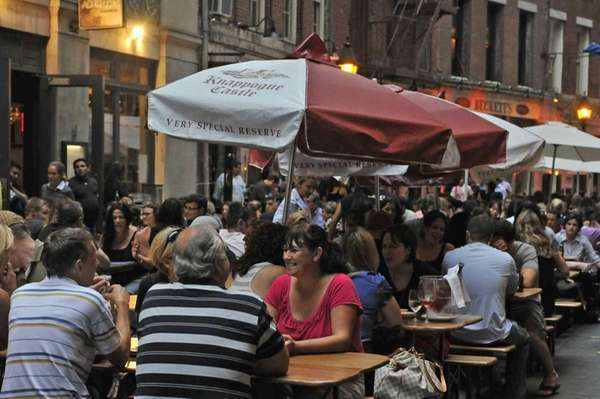 Patrons enjoy food and drinks on Stone Street