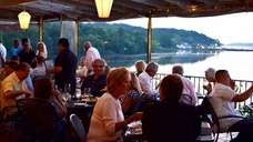 Diners take in the view while eating outdoors