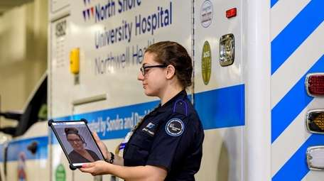 Northwell Health paramedic Danielle Conigliaro calls up a