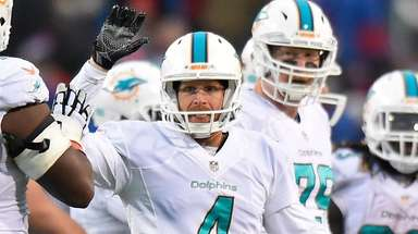 Dolphins punter Matt Darr celebrates after holding the