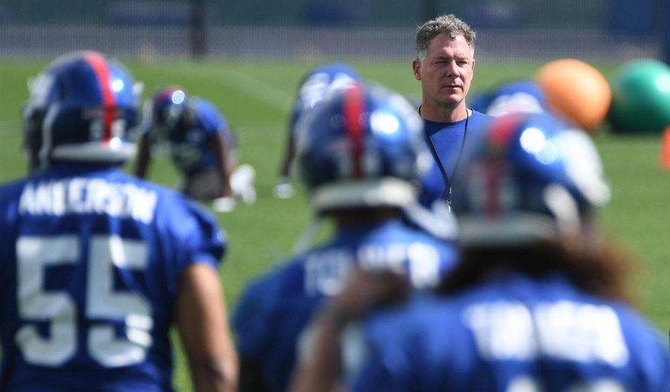 New York Giants head coach Pat Shurmur observes